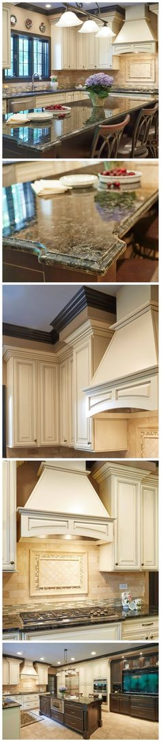 White kitchen with dark kitchen island and green granite.  Love the stove hood.