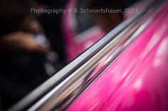 chrome strip of a pink stretch limo