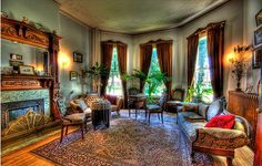 victorian-style-home-interior2 ornate rugs, mantle, curtains