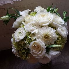 Whites and greens for the bride.  #bridalbouquet #larkspurchicagoweddings #whiteflowers #chicagoweddingflowers by larkspurchicago