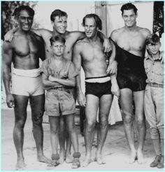 Duke Kahanamoku, Buster Crabbe, Johnny Weissmuller and friends on the beach at Waikiki, 1930s -vialoverofbeauty: