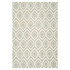 Featuring a geometric motif in dark grey and ivory, this hand-tufted wool rug adds a pop of pattern to your living room or master suite.   ...