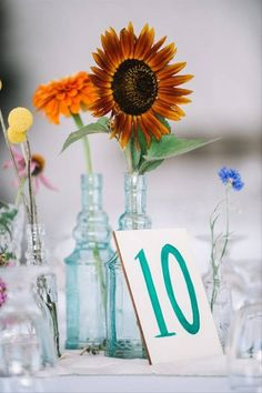 sunflower and wildflower wedding centerpiece with hand-painted table number Sunflower Bridesmaid Bouquet, Bridal Bouquet Fall, Sunflower Wedding Invitations, Sunflower Bouquets, Cascade Bouquet, Wedding Bouquets, Wedding Flowers, Simple Centerpieces, Wedding Centerpieces