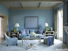 There's never such a thing as too much blue according to designer Tobi Fairley. She wrapped this glamorous Fayetteville, Arkansas, living room in layers of pale blue tones. For a hazy and serene look, the walls are a powder blue Venetian plaster. - HouseBeautiful.com