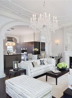 What a stunning living room with white decor and a touch of dark timber in some of the side tables and kitche cabinets. The chandelier looks just beautiful coming off the feature ceiling. Home Living Room, Living Room Decor, Living Spaces, Kitchen Living, Living Room Inspiration, Home Decor Inspiration, Decor Ideas, Home Interior, Interior Decorating