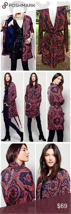 """FREE PEOPLE SENSUAL PAISLEY DUSTER JACKET ROBE Free People red, blue black paisley printed silky Sensual Printed Duster / Coat / Robe Seventies-inspired duster in a silky fabrication featuring patch pockets and waist tie. Contrast piping gives an elevated look. Lined in navy  can be worn as a robe  New Without Tags  *  Size:  Small retail price:  $168.00  *there is a dot on the tag to prevent store return  100% viscose machine wash cold  measures: 46"""" around bust 25"""" long sleeve 37"""" long…"""