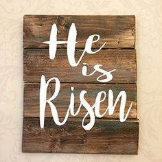 """He is Risen Easter Rustic Wooden Sign. This is a hand crafted sign on distressed pine board. Sign includes a saw tooth hanger attached to the back for hanging, but will also look great standing or propped up as decor. As each piece is hand crafted from raw materials, each will vary slightly but all will be lovely. Approximate Measurements: 8"""" X 10""""."""