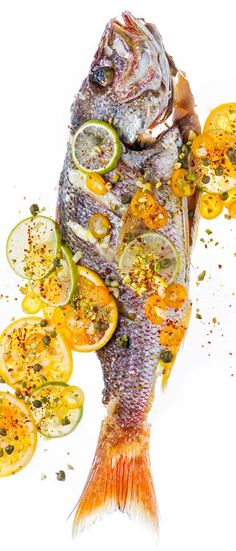 Style up this roasted red snapper with capers, pistachios, and citrus for a fish feast.