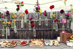 Love the rustic bottles..could use mason jars and twine....could alternate between flowers and tea lights