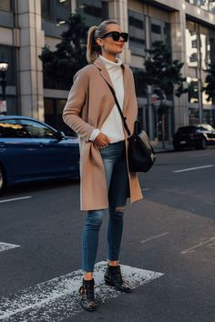 11bdd27b755 Blonde Woman Wearing AllSaints Camel Coat White Sweater Hudson Denim Ripped  Skinny Jeans Chloe Black Susanna