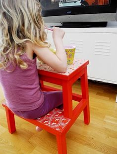 Stool used as a table and chair for a child. Genius.