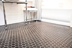 The hexagon mosaic on the bathroom floor gives a traditional bathroom a nice touch. #thetileshop