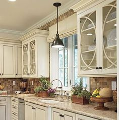 Off white kitchen cabinets. love the glass door details.