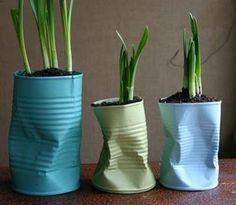 Love these crumpled & painted tin cans used as bulb planters.