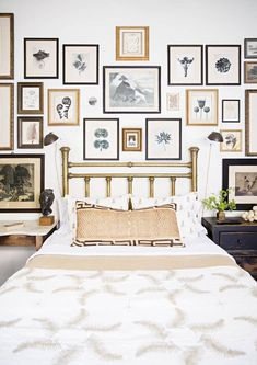 Gallery wall replaces the headboard.