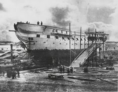 The first known photo of USS Constitution, the oldest commissioned warship afloat. The image depicts the ship in dry dock in 1858 undergoing repairs in Portsmouth, N.H.