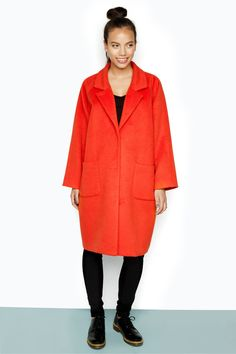 Oh what a coat. One of our softest, most luxurious, wooly textured coats to date. This oversized beauty with its three hidden snap buttons is the winter fashion winner you'll never regret investing in. PS: it's also fully lined!