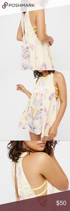 FP Silky Watercolor Dress Soft and silky, this Dream Free printed Tunic from Free People features a watercolor like, abstract Floral design in bright pastel colors.  Dipping low under the arms are three cure straps.  It also has a key hole open at the back that buttons at the neck.  Very lightweight and perfect to layer with.  Can be worn as a dress or Top depending on height - also makes the perfect slip!  Brand new with tags! Free People Dresses Mini