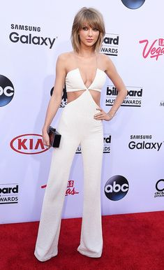 Taylor Swift in a Balmain jumpsuit, Effy Jewelry earrings, Edie Parker clutch, and Brian Atwood heels at the Billboard Music Awards.