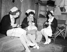 """""""Australia --- 9/1/42-Australia: U.S. Army nurses knitting""""  Do you think they were on call and that's why they didn't take their caps off?"""