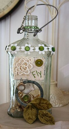 Altered Bottle with bale and green beads