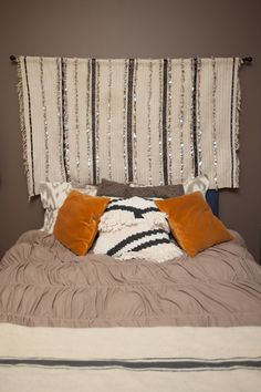 love the idea of a hanging head board!