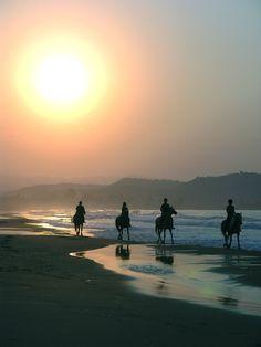 riding horses on the beach!
