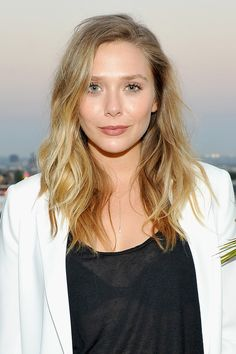 Elizabeth Olsen - Longer than a bob, not exactly a lob, the Long-Ass Lob is this fall's most ubiquitous–and versatile–haircut.