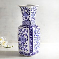 Inspired by the blue and white porcelain popularized in 14th century China, our glazed ceramic vase brings intrigue to your home. Hand-painted floral patterns in varying shades of cobalt cover this handcrafted <i>objet d'art</i>, resulting in a striking conversation piece that works great in an entryway, office or living room.