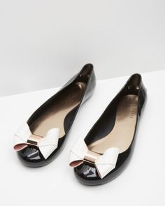 b719d68a50b6bb Large bow jelly pumps - Black