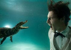 Man and Crocodile Under Water - Awesome Examples Of Under Water Photography