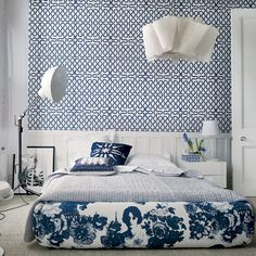 Usually a blue & white bedroom brings to mind a French Country toile... Thank God this is not your grandmother's blue & white bedroom! Don't you just *adore* all the modern pattern?