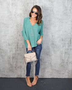 Keep it cozy in a cozy as ever sweater! This is a must own!Our High Volume Knit Sweater is textured to perfection in this v-neck, dolman sleeve silhouette. The