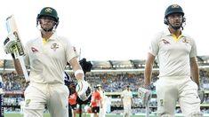 Australia's Steve Smith and Shaun Marsh leave the field