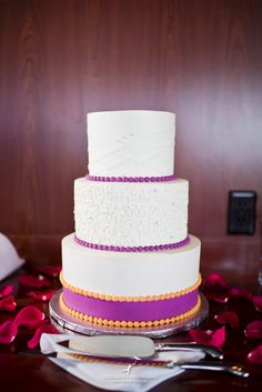 White On Detail Custom Wedding Cake With Purple And Orange Accents