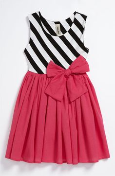 Little girl outfit: pink dress with black and white stripes.
