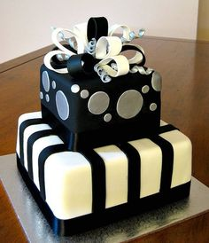 "Black and white birthday cake.  We can help achieve this look by checking out our website for cake dummies, cake boards and cupcake stands! 10% off with ""pinterest2013"" at www.dallas-foam.com"
