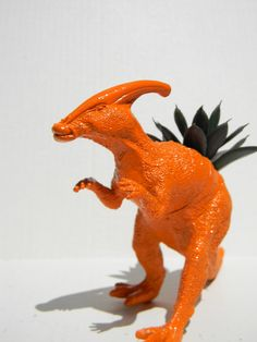 Dinosaur Decor Planter Bright Orange Dinosaur Succulent Planter Great Dino Decor for Office or Bedroom by crazycouture on Etsy https://www.etsy.com/listing/79505625/dinosaur-decor-planter-bright-orange