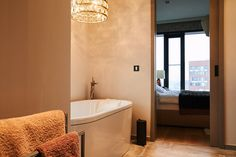 The couple spent $7,200 on the light fixture above their bathtub, which has a view of the new Elbphilharmonie concert hall.