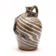 NC Folk Pottery, Burlon Craig, Snake Jug, two color swirl ware stoneware jug with a snake emerging from the rear, stamped on the bottom. 11 x 6 in.