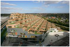 A view from the side of the 10 story 80 unit multi family complex designed by BIG Architects, just outside Copenhagen.