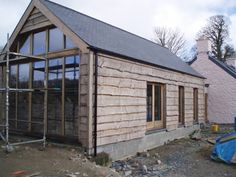 Private House, Pembrokeshire Softwood cladding is used here to blend a new extension to an old Welsh cottage. This heavy duty type of wany edged boarding is very effective in a rural setting.