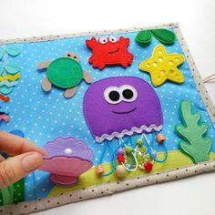 Busy book for kids on the marine theme a felt tablet for image 3 for kids, Busy book for kids on the marine theme, a felt tablet for learning activities with kids, a personal gift with the name of the child Diy Quiet Books, Baby Quiet Book, Felt Quiet Books, Quiet Book Patterns, Pattern Books, Jelly Roll Quilt Patterns, Sensory Book, Animal Crafts For Kids, Toddler Books