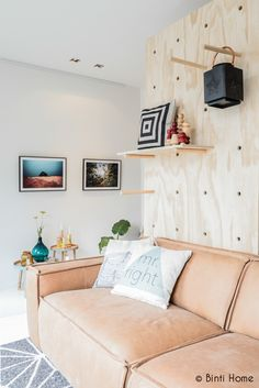 oversized-pegboard-wall-behind-sofa - Home Decorating Trends - Homedit Plywood Interior, Plywood Walls, My Living Room, Home And Living, Wall Behind Sofa, Peg Board Walls, Peg Wall, Interior Exterior, Bedroom Wall
