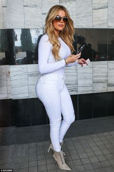 A new Khlo: Khloe Kardashian, seen here on Tuesday, is removing the Daddy tattoo she has on her back