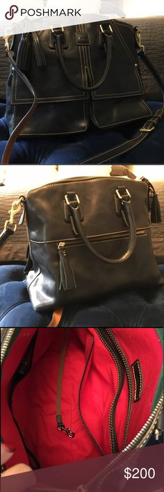 Large navy Dooney & Bourke leather purse Rarely used, includes detachable shoulder strap. It was a gift so the original price isn't exact, but based on comparable items. Dooney & Bourke Bags Satchels