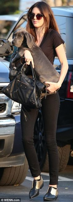 Casually dressed: Kendall Jenner shopped at Fred Segal in a black T-shirt, skinny jeans and pointed shoes