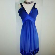 Lucy Royal Blue Dress How hot will you look in this dress? With this white bubble at the bottom and plunging neckline, this dress will have all eyes on you! It is very soft and flowing, and has a bit of shimmer.  Zips up the side. Beautiful royal blue color, must see to appreciate. You know you have something coming up that would be perfect for this dress! Lucy Dresses