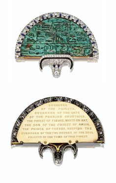 Cartier Art Deco Egyptian Revival Onyx, Diamond, Enamel, Sapphire, Platinum, and Gold Fan Brooch (1923) by Cartier, London - composed of an Egyptian glazed steatite plaque of semicircular shape, (c.600 B.C.) inscribed with hieroglyphs, inscription on reverse.