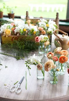 "Brides.com: A Summer Camp-Themed Wedding in NH. The bride, with the help of her sister and mother, designed all the couple's floral decor, including matching bouquets. Ariel ordered flowers from a local grocery store and picked them up ""Friday morning before the wedding and kept them on the porch of our cabin until we arranged them Saturday morning,"" she says."